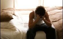 man headache on bed