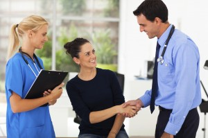 woman handshaking with doctor after checkup