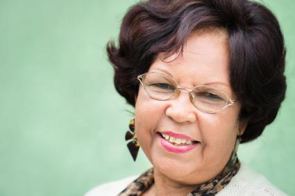 Portrait of happy elderly black lady with eyeglasses smiling