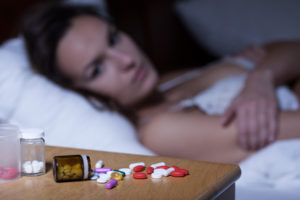 Sleeping pills on bedside table