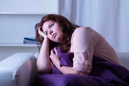 Woman at night suffering from fibromyalgia
