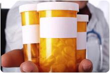 doc-hlding-pill-bottles1
