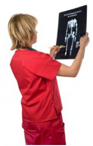 doc-looking-at-x-ray-203x300