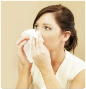 woman-sneezing-290x300