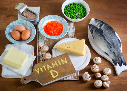 Foods highest in vitamin D on wooden background. Top view